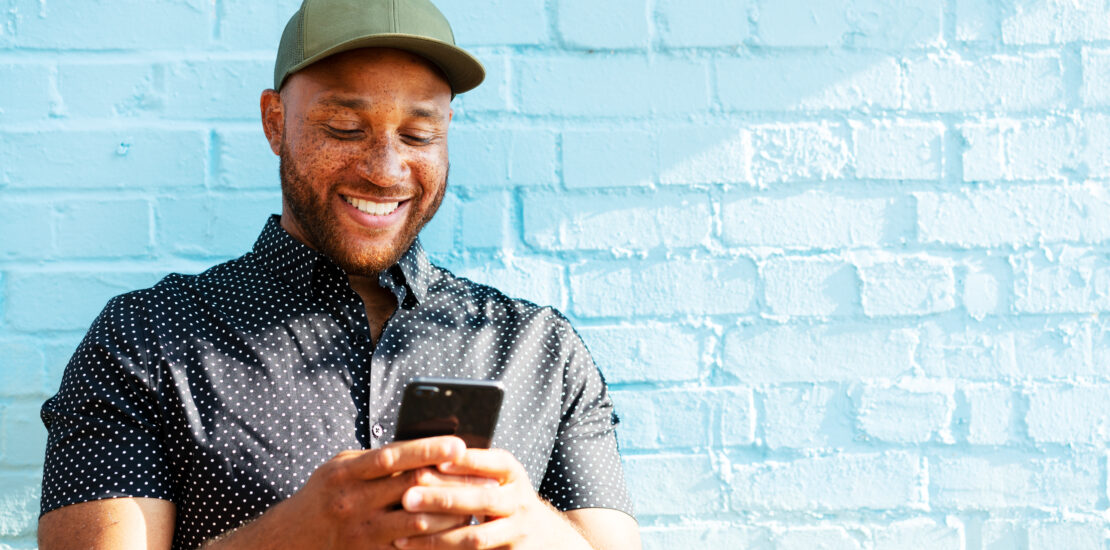 Happy person checking phone